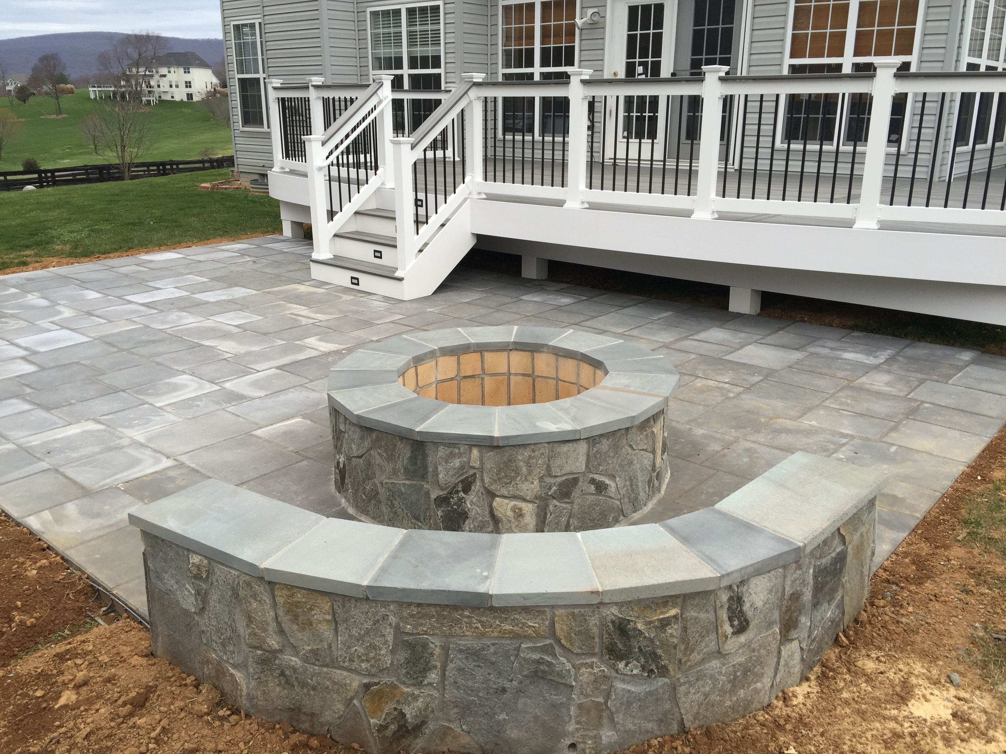 A Beautiful Paver Patio With Stone Seating Walls And A Fire with dimensions 3264 X 2448