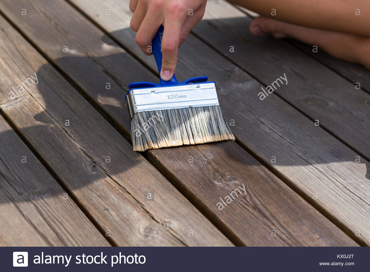 Oiling Terrace Rail With Wide Brush Painting Wooden Patio regarding size 1300 X 956