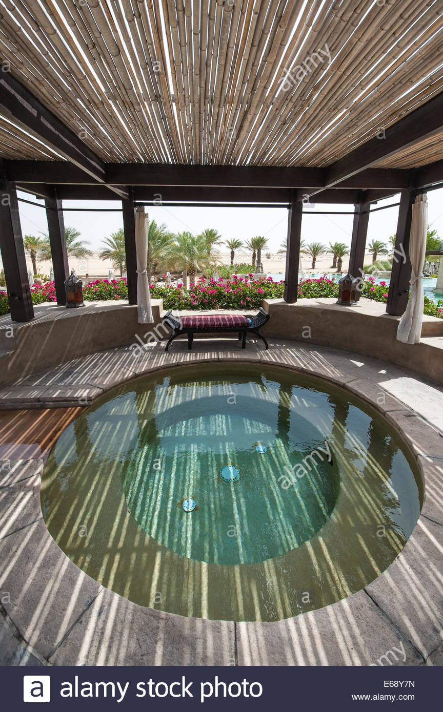 Pool Hot Tub Jacuzzi Deck Patio Area At The Bab Al Shams in measurements 864 X 1390