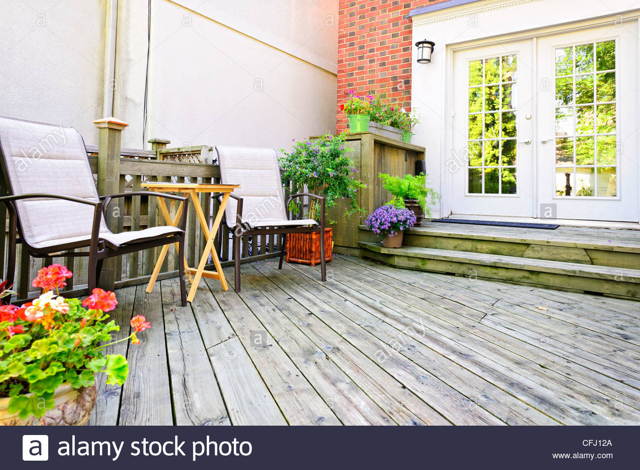Wooden Deck On House With Chairs And French Doors Stock regarding measurements 1300 X 954