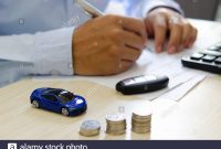 Toy Car Finance Calculator Car Keys And Papers On The Desk with regard to proportions 1300 X 951